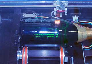 laser engraving the champagne bottle