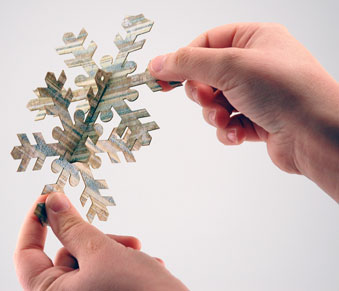 Assembling the paper snowflakes.